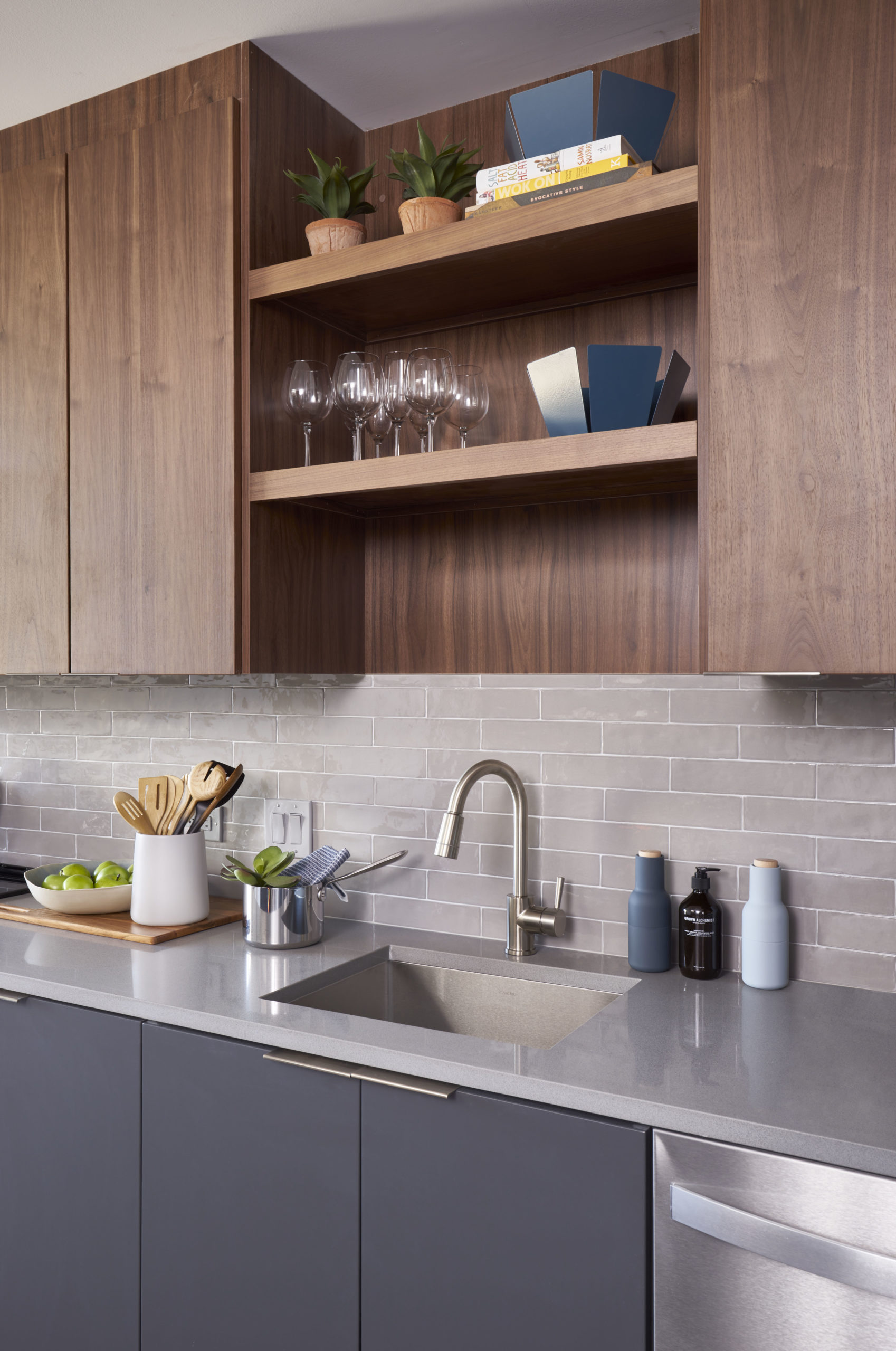 dark wood and gray cabinets white counter tops and stainless steel in modern vyv apartment