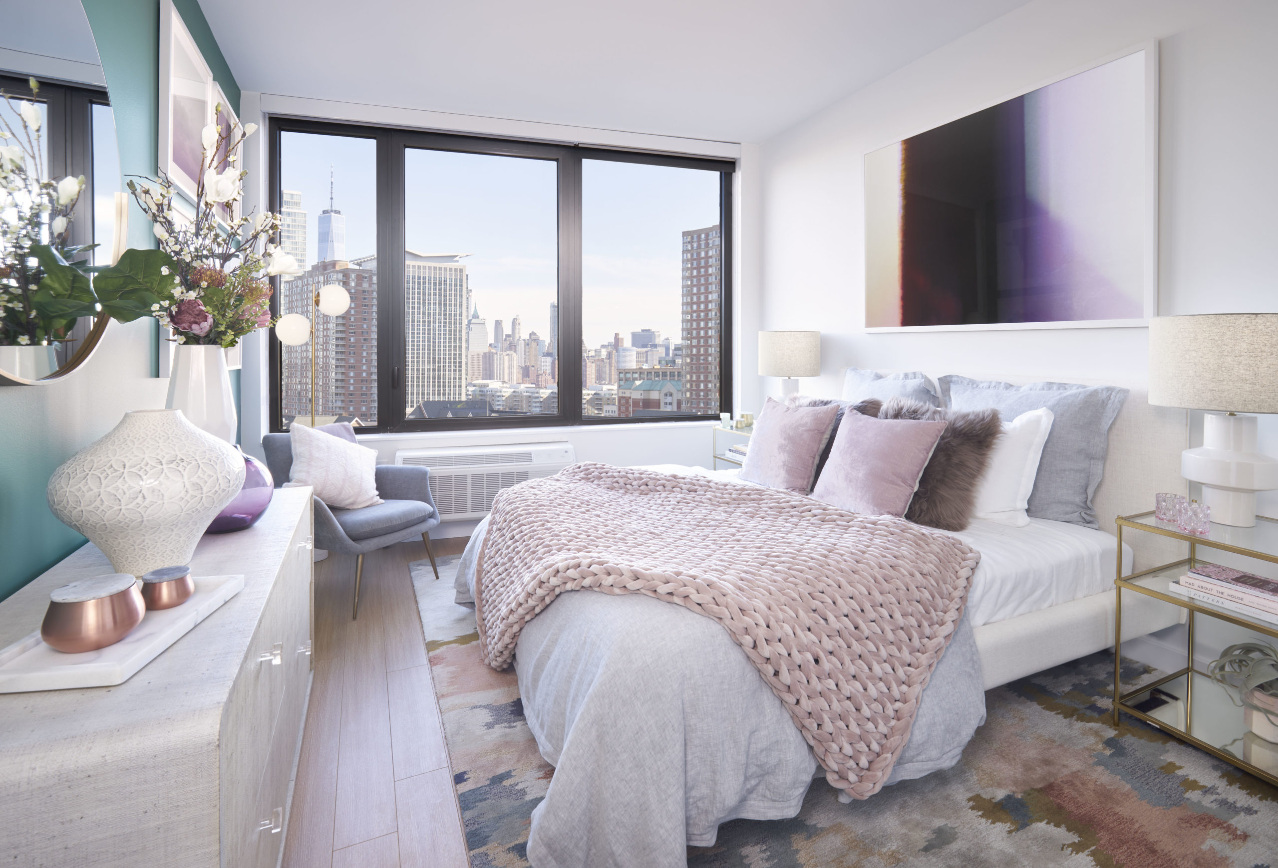 newport apartments in jersey city with wall to wall window and giant white bed