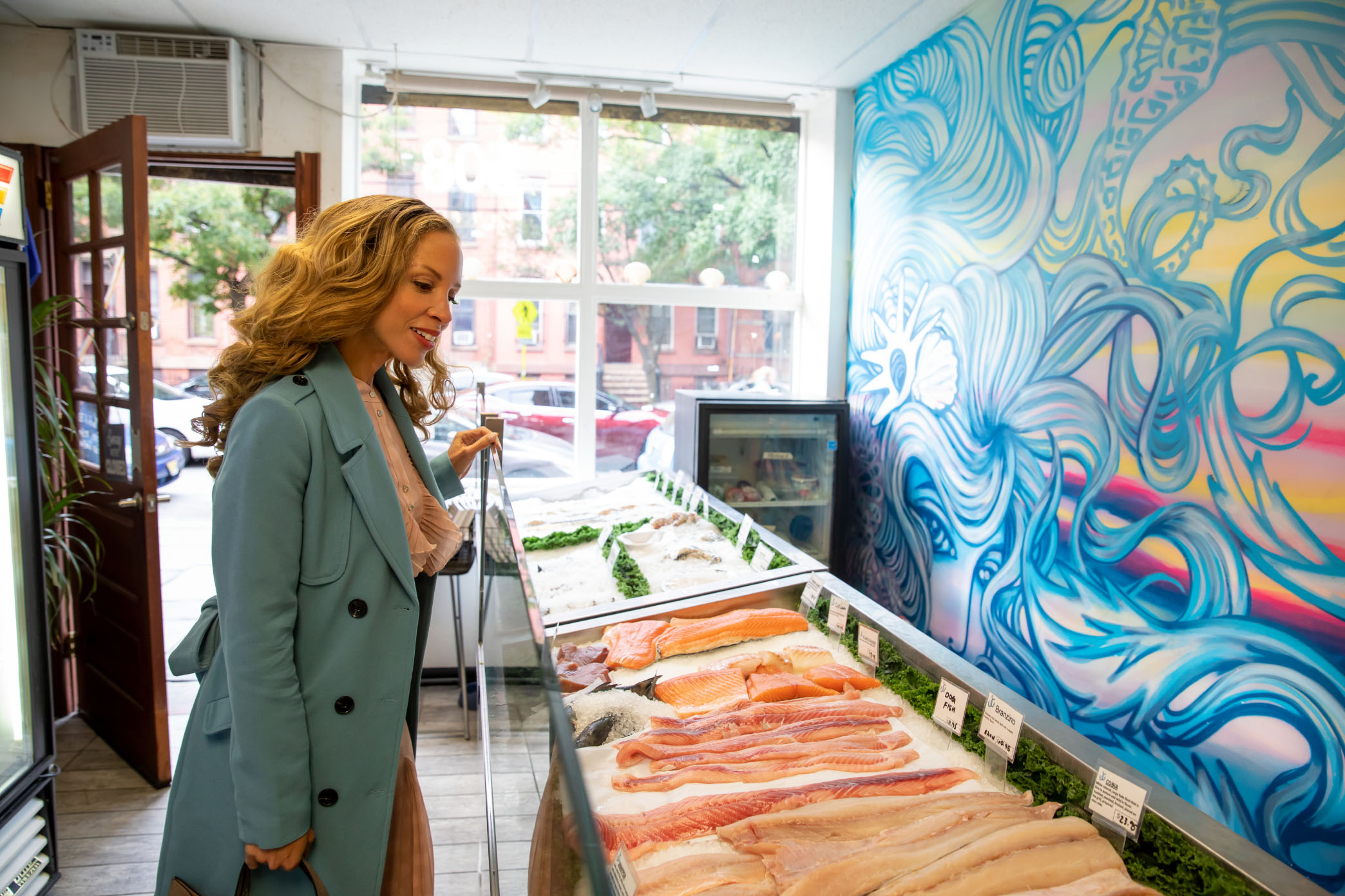 woman shopping at jersey city fish stand near vyv apartment